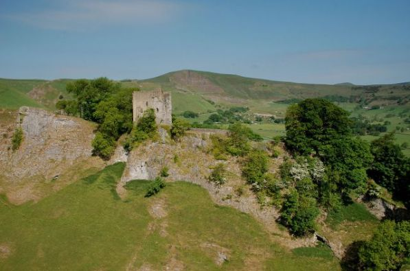 Peveril Castle from Cavedale, with Mam Tor, the Shivering Mountain, in the distance. Image: Rob Bendall
